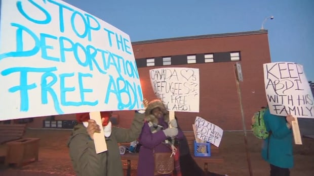 Supporters of Abdi demonstrated in Lower Sackville, N.S., on Tuesday, where Prime Minister Justin Trudeau was holding a town hall meeting.