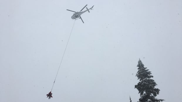 Fernie Search and Rescue technicians head out Tuesday to retrieve the body of a backcountry skiier from Calgary, Alberta, who died Monday in an avalanche in the East Kootenay's Lizard Mountain range.