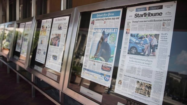 Newspaper front pages are displayed at the Newseum in Washington on July 10, 2017. Newsprint is the latest Canadian product to be hit with preliminary countervailing duties from the United States.