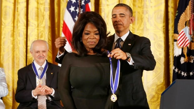 Oprah Winfrey receives the Presidential Medal of Freedom from Barack Obama in 2013. Following a speech at the Golden Globes last weekend, it suddenly feels as if she could soon be giving them out.