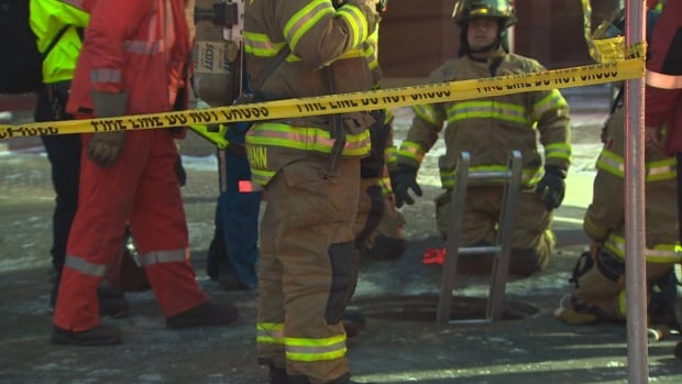Fire crews rescued a woman from a downtown manhole Wednesday morning after an explosion blew the cover off.