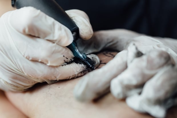 Burning away hate: Hamilton tattoo shop offering free laser removal of racist tattoos