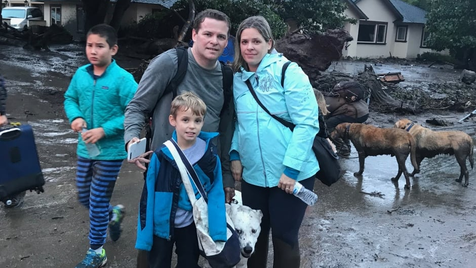Ben Hyatt, pictured here with his wife, son and dog, had to flee his Montecito, Calif., home after a mudslide hit the town.