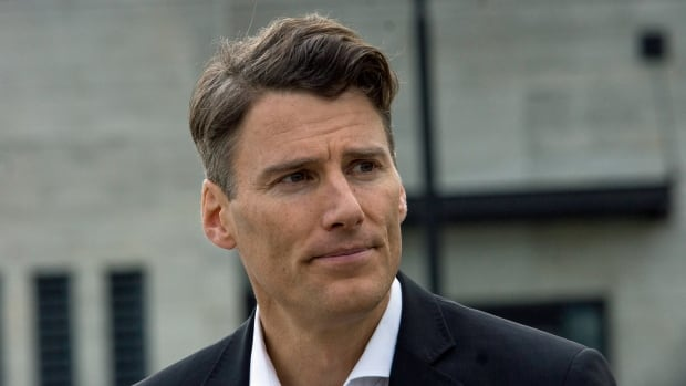 Mayor Gregor Robertson speaks outside Vancouver City Hall on Wednesday after announcing he won't be seeking re-election in the fall. Had he run and won, it would have been his fourth term.