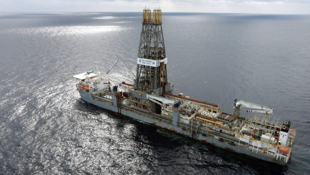 In this file photo, Chevron's Discoverer Deep Seas drills for oil in the Gulf of Mexico. New York City officials say they will begin the process of dumping about $5 billion in pension fund investments in fossil fuel companies, including Chevron, because of environmental concerns.