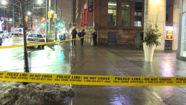 Toronto police say a man has been rushed to hospital after a fight between two groups of people downtown led to an early morning shooting on Thursday.