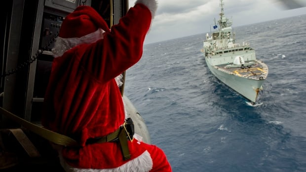 Santa flies in a Sea King helicopter over HMCS Charlottetown as it operates in the eastern Mediterranean Sea during Operation Reassurance on Dec. 24.