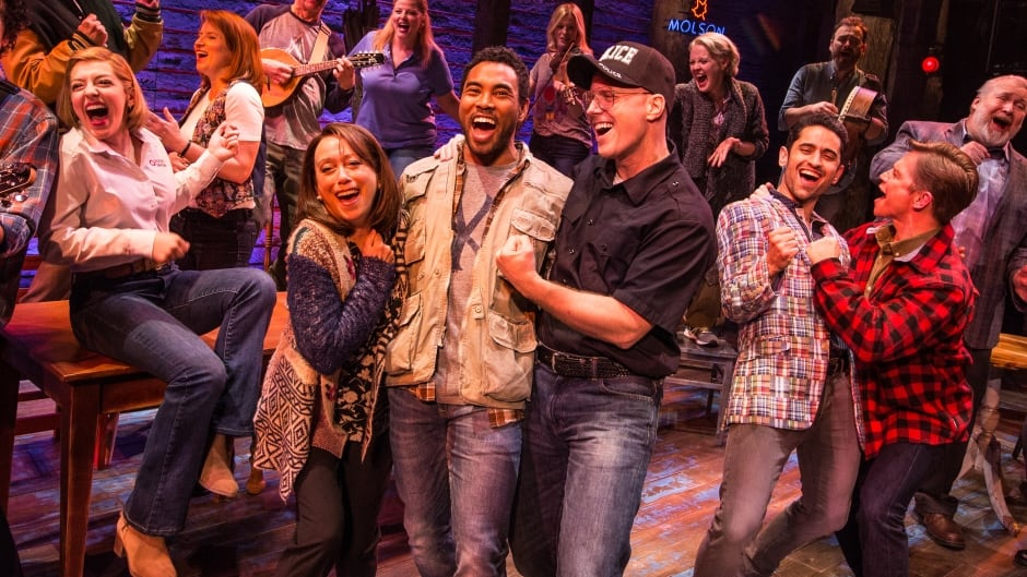 Kevin Vidal is surrounded by his fellow castmates in the new, all-Canadian production of Come From Away, which premieres in Winnipeg before moving to Toronto.