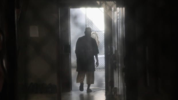 A prisoner walks to an outdoor area on Oct. 22, 2016, at the U.S. Naval Station at Guantanamo Bay, Cuba.