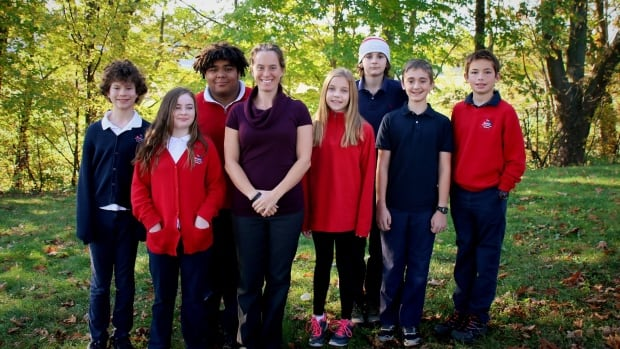 Teacher Temma Frecker (centre) with Will Mercer (third from left) and the rest of the grades 6-8 class at The Booker School.