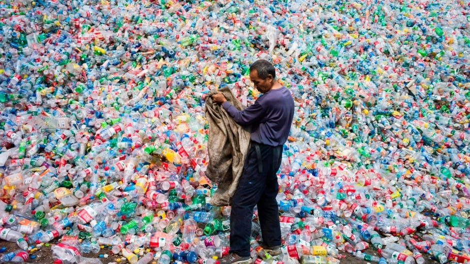 A Chinese labourer sorts plastic bottles for recycling in Dong Xiao Kou village, on the outskirts of Beijing.
