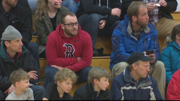 Jordan Frenette watches a Phantoms game at Bathurst High School. He was captain of the basketball team 10 years ago when seven players were killed in a crash.