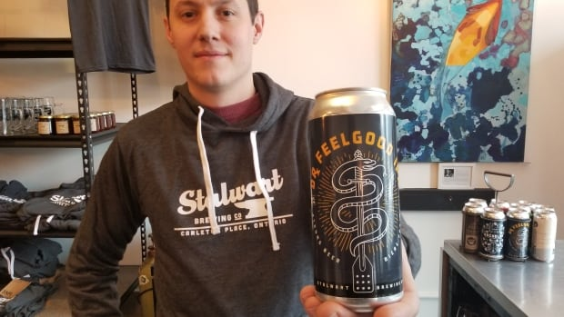 Stalwart Brewing Company co-owner Adam Newlands shows off a can of Dr. Feelgood IPA featuring the logo rejected by the Liquor Control Board of Ontario.