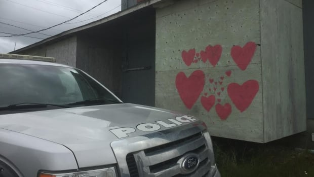 Six officers share this home on Kashechewan First Nation. Kent Elson, lawyer for the Mushkegowuk Council, said six officers spray painted the hearts to cover offensive obscenities.