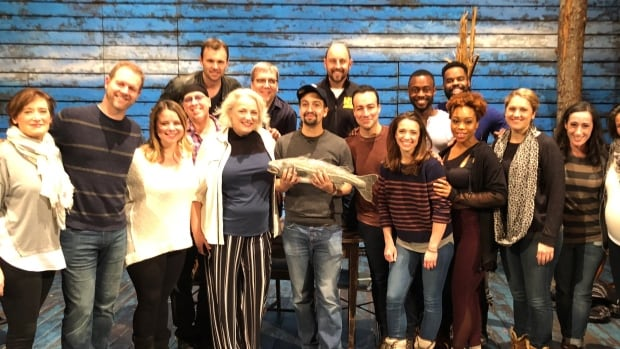 Hamilton creator Lin Manuel Miranda, pictured holding the cod, tweeted this photo after taking in a performance of Come From Away.
