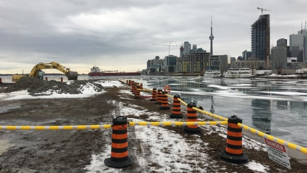 Construction crews will fill in two water channels to create space for a nine- hectare (20 acres) park on the Port Lands.