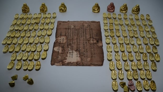 Two Chinese nationals are each charged with two counts of fraud in connection with the alleged gold scam.
