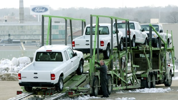 A worker loads Ford Ranger trucks on a transport at the Ford Twin Cities Assembly Plant in January 2006. Ford is recalling 2,900 of the vehicles from this plant for having defective airbag inflators linked to two deaths.