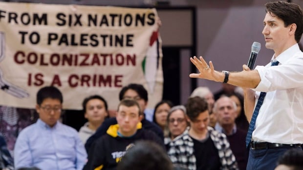 Town hall tour stop at Western University mostly lovefest for Prime Minister Justin Trudeau facing conflict scandal, trade