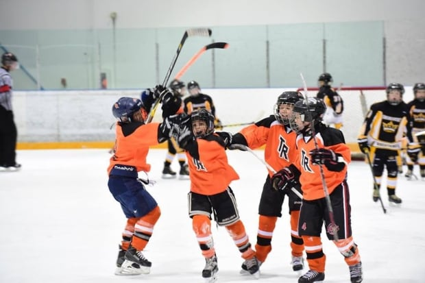 Team Revolution celebrates a goal on the ice (credit Team Revolution)