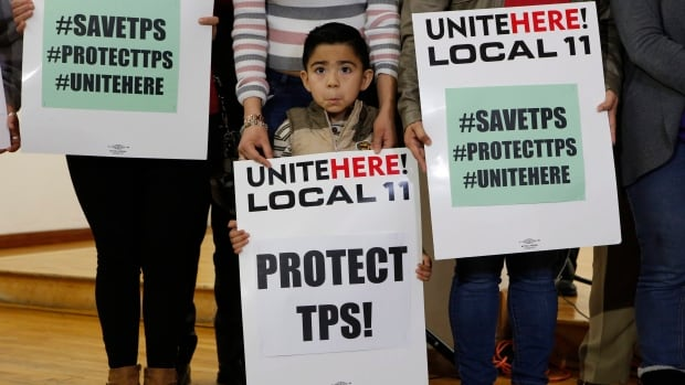 In this Monday, Jan. 8, 2018 photo, Mateo Barrera, 4 originally from El Salvador, whose family members benefit from Temporary Protected Status, TPS, attends a news conference in Los Angeles. This week' news that the Trump administration is ending TPS for 200,000 migrants from El Salvador is also rattling nerves in neighboring Honduras.