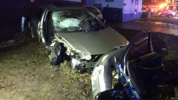 Windsor police are searching for a male suspect who fled after crashing into a house on Dufferin Place Thursday night.
