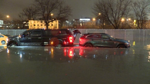 Cars were stuck on a flooded Bayview Extension early Friday morning.