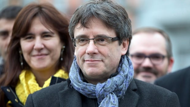 Ousted Catalan leader Carles Puigdemont, centre, is shown with elected Catalan lawmakers of his Together for Catalonia party at a park in Brussels on Jan. 12. Several questions remain about the leadership of the region and its future relationship to Madrid after the December vote.