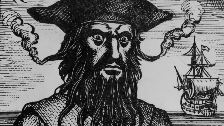 Captain Edward Teach, better known as Blackbeard, a pirate who plundered the coasts of the West Indies, North Carolina and Virginia. His hair is woven with flaming fuses to increase his fearsome appearance.