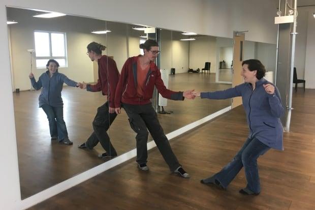 Robert Van Waarden and Laura Weatherbie strike dance pose at Charlottetown's DownStreet Dance Studio