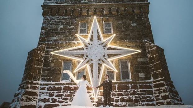 Hilary Butler's dream of a winter wedding came true on New Year's Eve, as snow fell while taking photos at the historic Signal Hill site in St. John's.