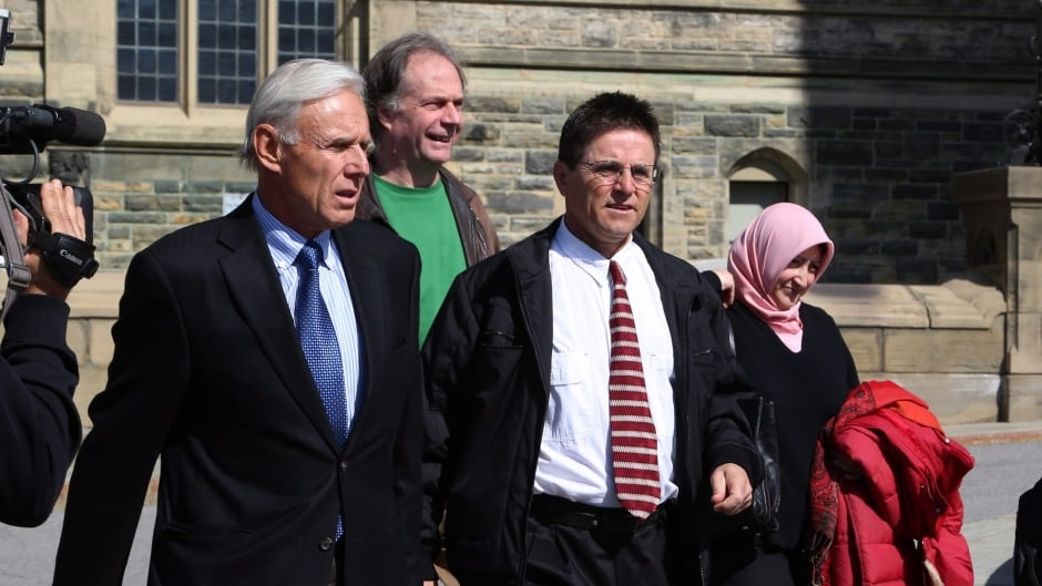 Hassan Diab (centre), a former Ottawa University professor, was ordered extradited to France by the Canadian government in 2014.