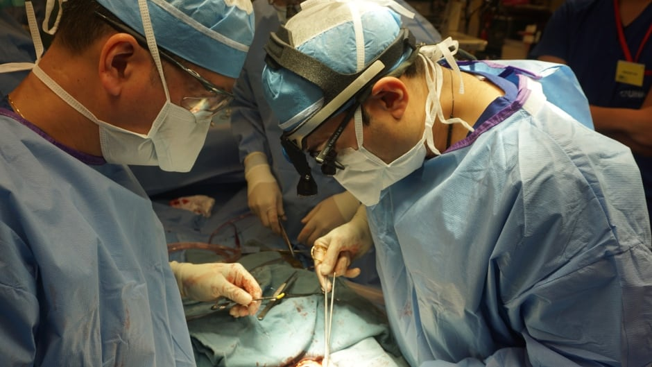 Cardiac surgeon Dr. Mitesh Badiwala, right.