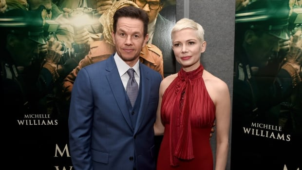 Wahlberg, left, was paid $1.5 million US for 10 days of reshoots, while Williams was reportedly paid less than $1,000 for the same work.