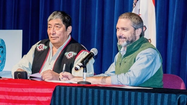 Teslin Tlingit Council Chief Richard Sidney with Yukon Premier Sandy Silver, signing an intergovernmental agreement in Teslin on Friday.