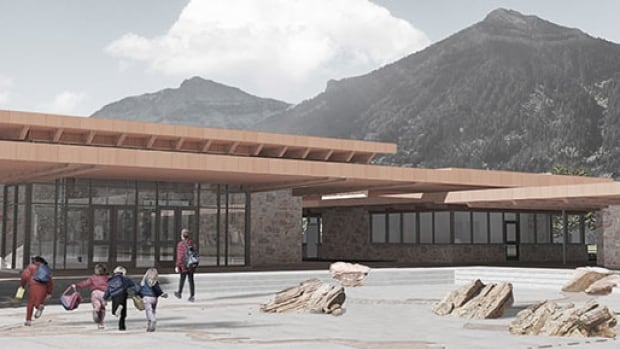 A rendering shows the 'Town Plaza' design of the planned Waterton Lakes National Park visitor centre.