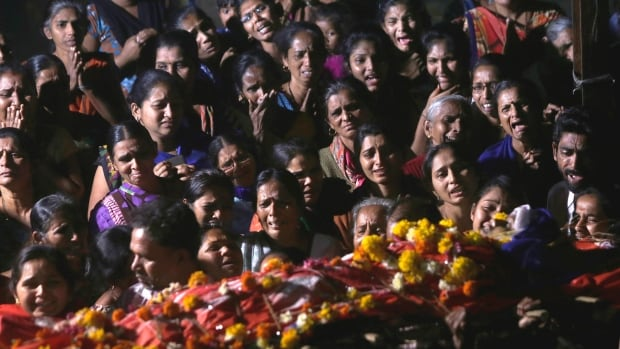 Relatives and friends mourn at the funeral of Sanskruti Mayavanshi, one of the victims of a boat accident in Dahanu, 130 kilometres from Mumbai, on Saturday after a ferry boat carrying schoolchildren sank in the Arabian Sea.