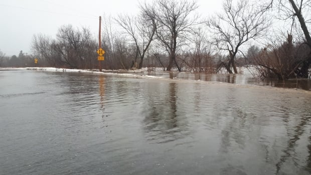 Tripp Settlement Road near Burtts Corner, N.B., was covered with water Saturday morning.