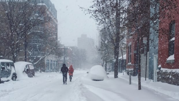Officials are asking Montrealers to stay off the roads as much as possible due to bad conditions and poor visibility from the snow.