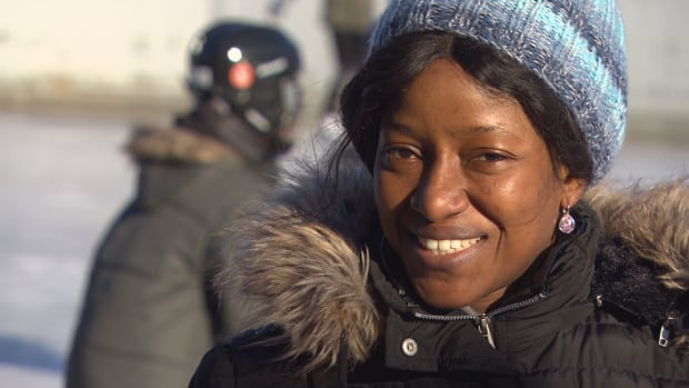 Mercy Aje tries out skating for the first time on Jan. 13, 2018. She and her three children arrived in Canada from Nigeria six months ago.