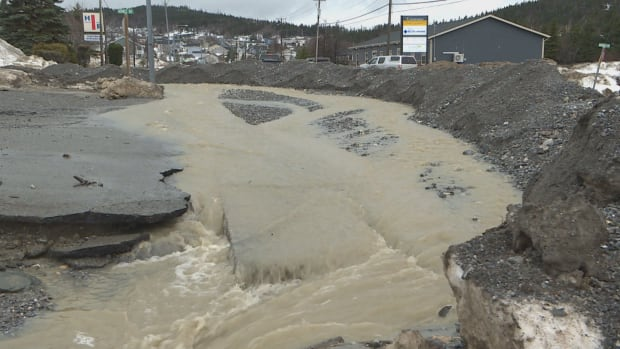 Heavy rainfall and snowmelt has done severe damage to Corner Brook roads and buildings, prompting the mayor to declare a state of emergency.