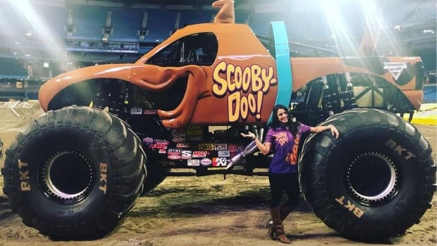 Haley Gauley stands before her Monster Truck, Scooby-Doo, at the Rogers Centre in Toronto.