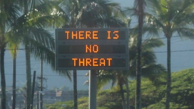 "A highway median sign broadcasts a message of ""There is no threat"" in Kaneohe, Hawaii. State emergency officials mistakenly sent out an emergency alert Saturday, warning of an imminent missile strike."