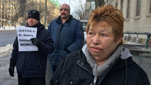 Stella Chapman, a St. Anne's residential school survivor, stands outside the Justice Canada building in Ottawa Monday during a rally in support of her case.