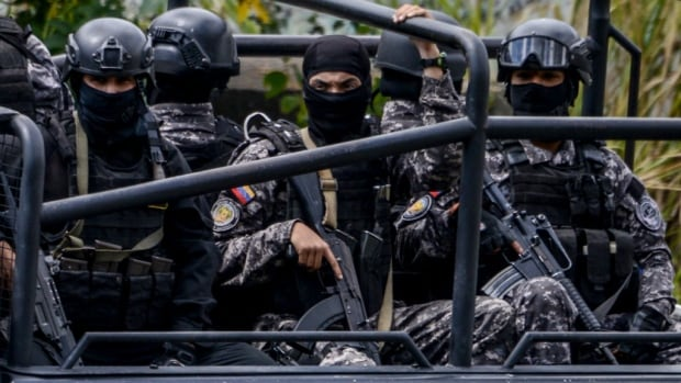 Members of Venezuela's intelligence service patrol Caracas as an operation to capture Oscar Perez, the Venezuelan helicopter pilot who dropped grenades on the Supreme Court last year during anti-government protests, is carried out on Monday.