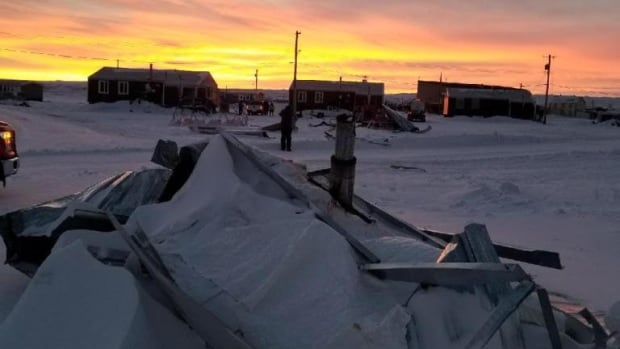 Crumpled metal in Paulatuk, N.W.T., Monday. Crews were having trouble getting to the community where residents have been without power since Sunday.