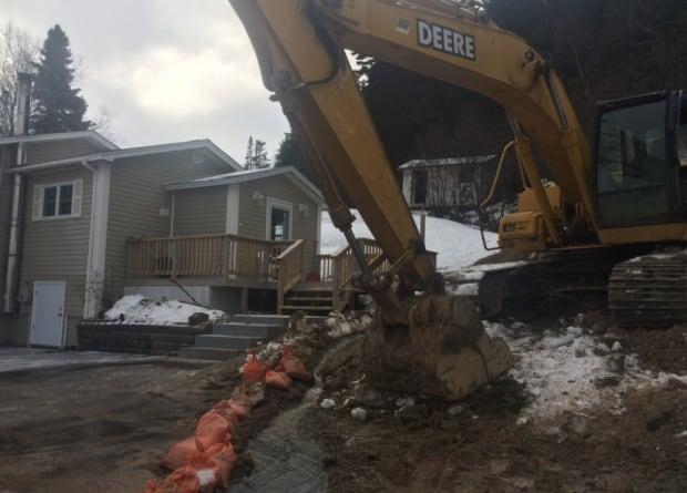 Garage damage backhoe help