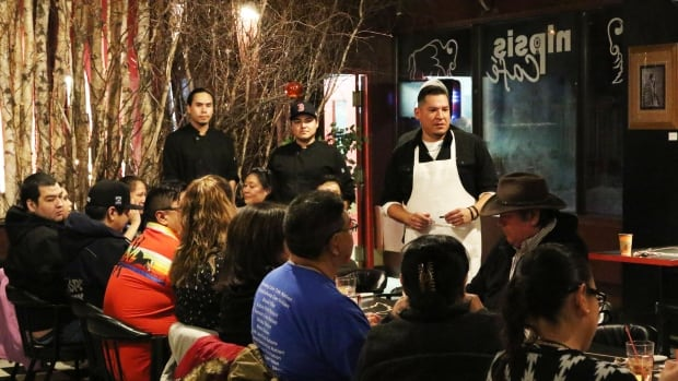 Rich Francis speaks to a group of Maskwacis residents about how to recapture their culture through traditional foods.