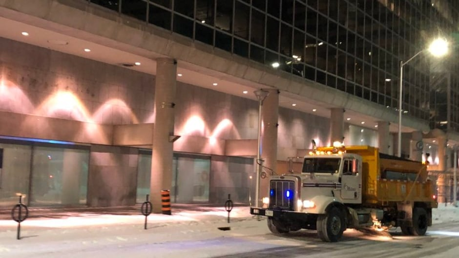An Ottawa salt truck makes its way down Queen Street on Jan. 16. Corrosive road salt is responsible for $3 billion in vehicle depreciation each year in Quebec and Ontario alone.