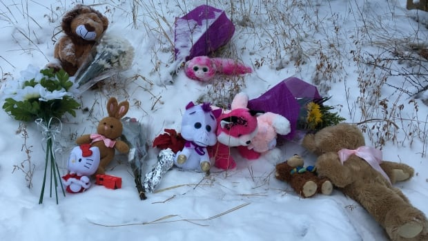 A makeshift memorial continues to grow in Toronto a day after a girl, 5, was pinned between two vehicles after school and later died in hospital. Her dad was also injured.